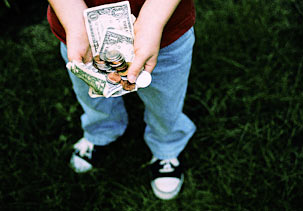 Teen holding money in hands
