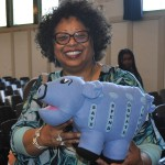 Linda Sue Collins, Teacher-Librarian at Ray Elementary, Chicago Public Schools with the Money Savvy Pig hand puppet